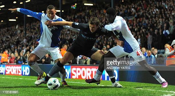 Manchester City's Bosnian forward Edin Dzeko vies with Blackburn Rovers' US defender Jermaine Jones and Blackburn Rovers' Senegalese forward Mame...