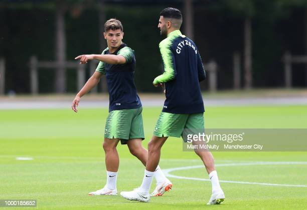 Manchester City's Brahim Diaz talks with Riyad Mahrez during training at Manchester City Football Academy on July 16 2018 in Manchester England