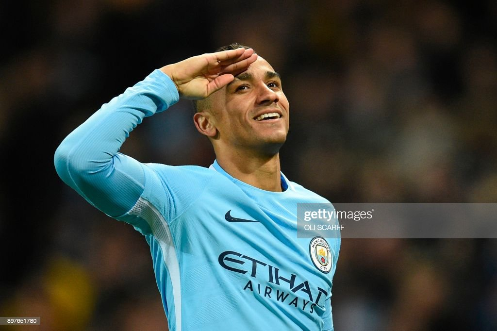 TOPSHOT - Manchester City's Brazilian defender Danilo celebrates scoring their fourth goal during the English Premier League football match between Manchester City and Bournemouth at the Etihad Stadium in Manchester, north west England, on December 23, 2017. / AFP PHOTO / Oli SCARFF / RESTRICTED TO EDITORIAL USE. No use with unauthorized audio, video, data, fixture lists, club/league logos or 'live' services. Online in-match use limited to 75 images, no video emulation. No use in betting, games or single club/league/player publications. /