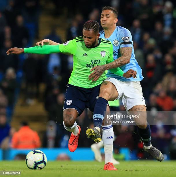 Manchester City's Brazilian defender Danilo vies with Cardiff City's Dutchborn Caracao midfielder Leandro Bacuna during the English Premier League...