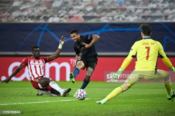 Manchester City's Brazilian forward Gabriel Jesus fights for the ball with Olympiakos' Senegalese defender Ousseynou Ba next to Olympiakos'...