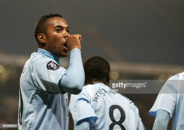 Manchester City's Brazilian forward Robinho celebrates scoring their 2nd goal against FC Twente during their UEFA Cup Group A football match at the...
