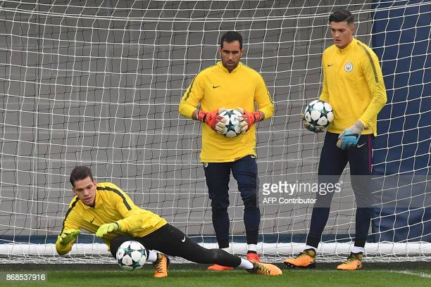 Manchester City's Brazilian goalkeeper Ederson and Manchester City's Chilean goalkeeper Claudio Bravo take part in a team training session at the...