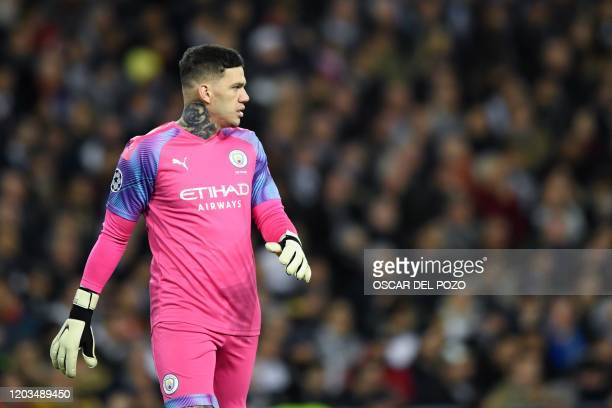 Manchester City's Brazilian goalkeeper Ederson attends the UEFA Champions League round of 16 firstleg football match between Real Madrid CF and...