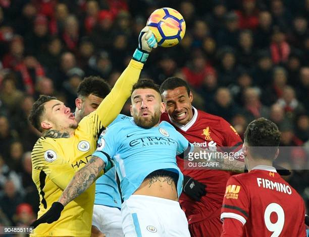 Manchester City's Brazilian goalkeeper Ederson comes out to punch the ball during the English Premier League football match between Liverpool and...