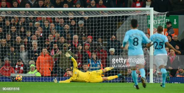 Manchester City's Brazilian goalkeeper Ederson dives but fails to stop Liverpool's English midfielder Alex OxladeChamberlain's shot for the opening...