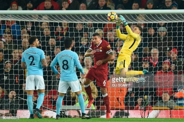 Manchester City's Brazilian goalkeeper Ederson fails to hold the ball as he attempts a catch during the English Premier League football match between...