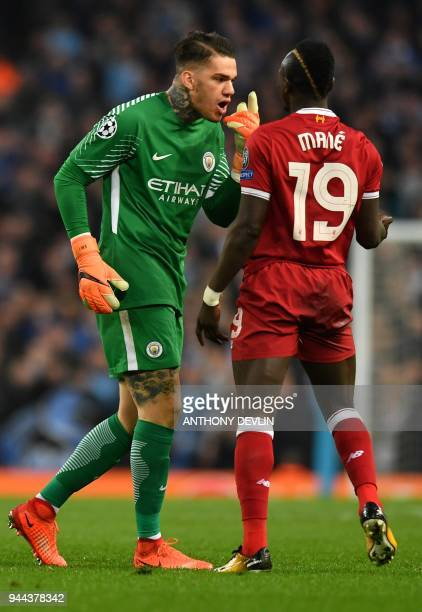 Manchester City's Brazilian goalkeeper Ederson gestures towards Liverpool's Senegalese midfielder Sadio Mane after Mane challenged Manchester City's...