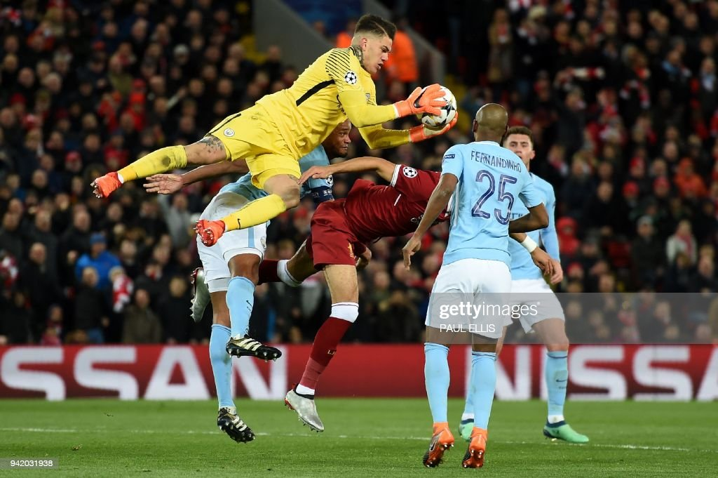 TOPSHOT - Manchester City's Brazilian goalkeeper Ederson gets the ball during the UEFA Champions League first leg quarter-final football match between Liverpool and Manchester City, at Anfield stadium in Liverpool, north west England on April 4, 2018. /