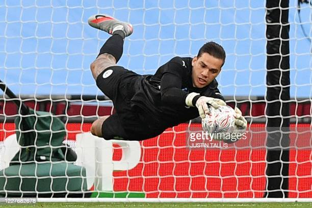 Manchester City's Brazilian goalkeeper Ederson makes a save during the English FA Cup semi-final football match between Arsenal and Manchester City...