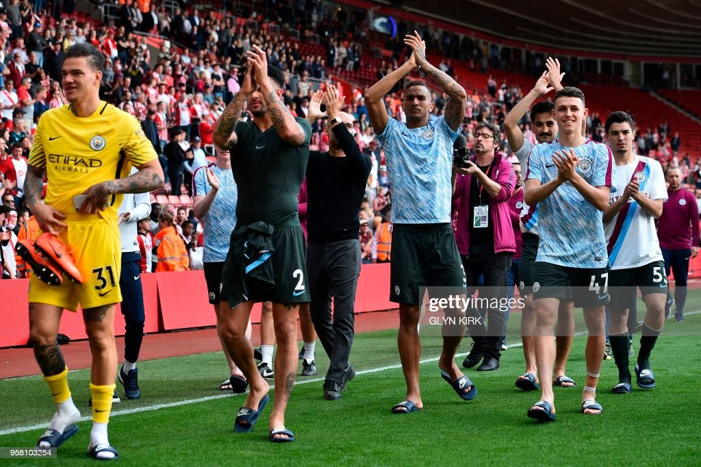 Manchester City's Brazilian goalkeeper Ederson, Manchester City's English defender Kyle Walker, Manchester City's Brazilian defender Danilo and Manchester City's English midfielder Phil Foden applauds the fans at the end of the English Premier League football match between Southampton and Manchester City at St Mary's Stadium in Southampton, southern England on May 13, 2018. (Photo by Glyn KIRK / AFP) / RESTRICTED TO EDITORIAL USE. No use with unauthorized audio, video, data, fixture lists, club/league logos or 'live' services. Online in-match use limited to 75 images, no video emulation. No use in betting, games or single club/league/player publications. /
