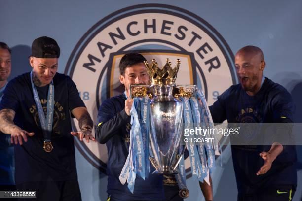 Manchester City's Brazilian goalkeeper Ederson Manchester City's Spanish midfielder David Silva and Manchester City's Belgian defender Vincent...