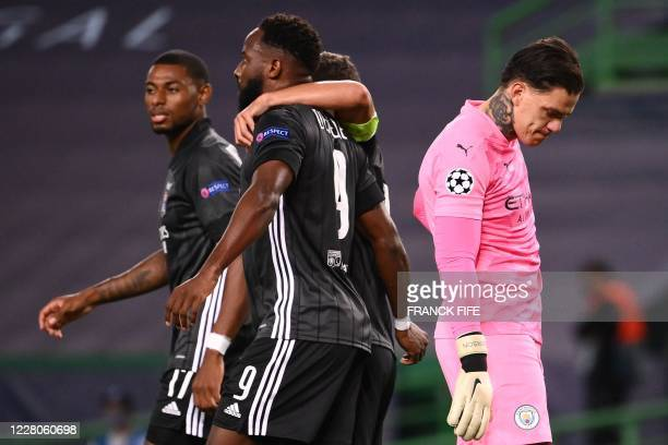 Manchester City's Brazilian goalkeeper Ederson reacts to Lyon's French forward Moussa Dembele's second goal during the UEFA Champions League...