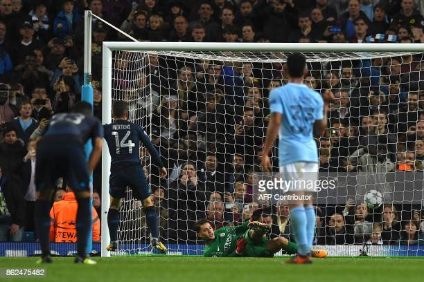 Manchester City's Brazilian goalkeeper Ederson saves a penalty dhot from Napoli's Belgian striker Dries Mertens during the UEFA Champions League...