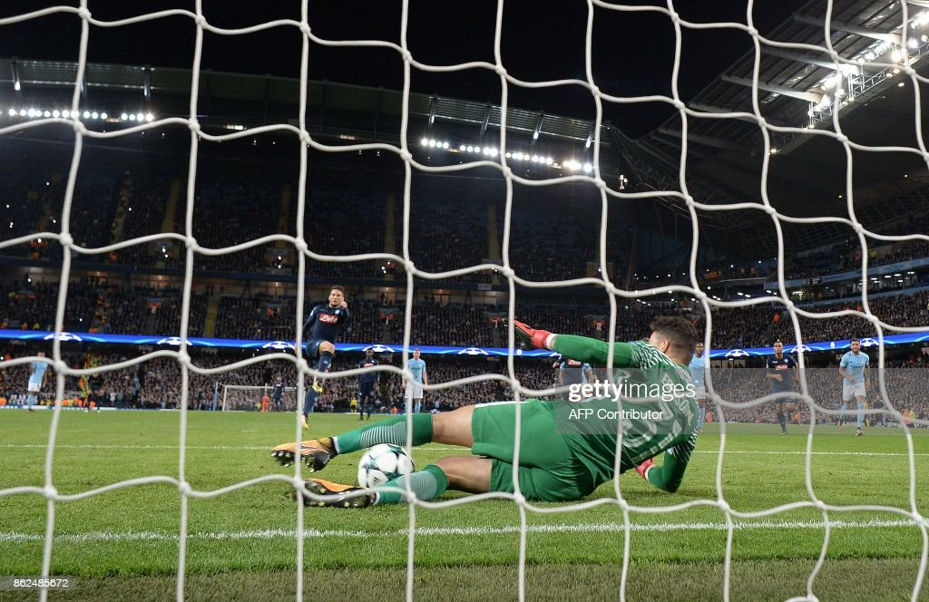 Manchester City's Brazilian goalkeeper Ederson saves a penalty shot from Napoli's Belgian striker Dries Mertens during the UEFA Champions League Group F football match between Manchester City and Napoli at the Etihad Stadium in Manchester, north west England, on October 17, 2017. /