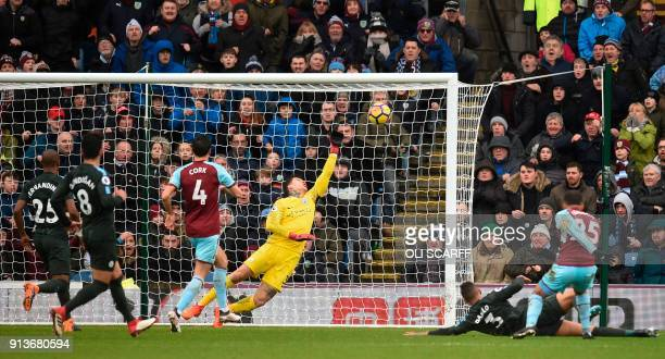 Manchester City's Brazilian goalkeeper Ederson saves a shot from Burnley's English midfielder Aaron Lennon during the English Premier League football...