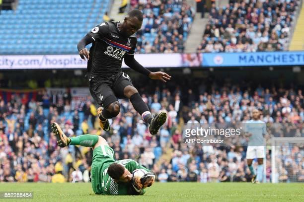 Manchester City's Brazilian goalkeeper Ederson saves the ball from Crystal Palace's Zaireborn Belgian striker Christian Benteke during the English...