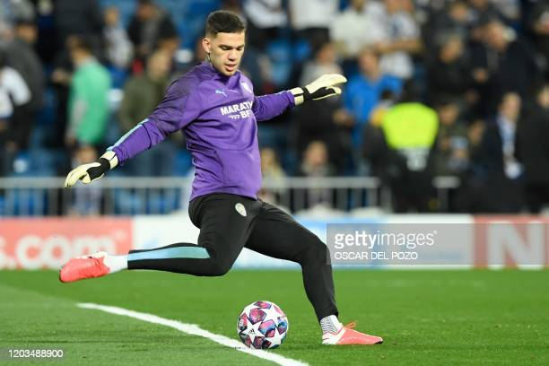 Manchester City's Brazilian goalkeeper Ederson warms up before the UEFA Champions League round of 16 firstleg football match between Real Madrid CF...