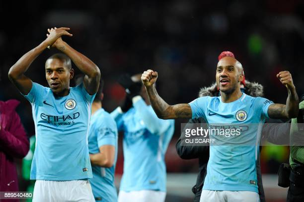 Manchester City's Brazilian midfielder Fernandinho and Manchester City's English midfielder Fabian Delph celebrate their 12 victory at the end of the...