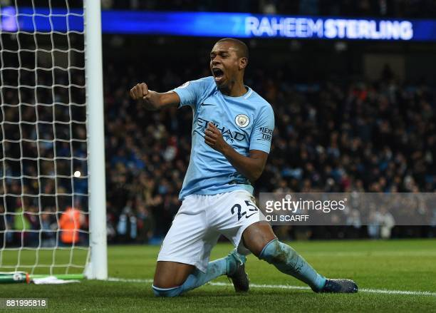 Manchester City's Brazilian midfielder Fernandinho celebrates after Manchester City's English midfielder Raheem Sterling scores his team's second...