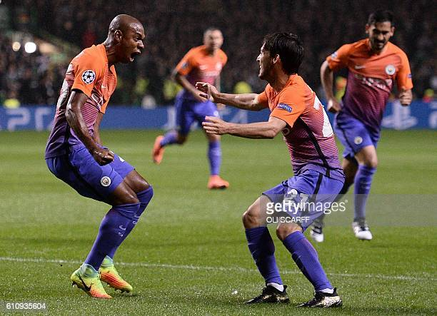 Manchester City's Brazilian midfielder Fernandinho celebrates scoring his team's first goal during the UEFA Champions League Group C football match...