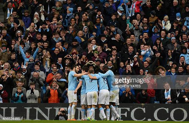 Manchester City's Brazilian midfielder Fernandinho celebrates with team mates after scoring during the English Premier League football match between...