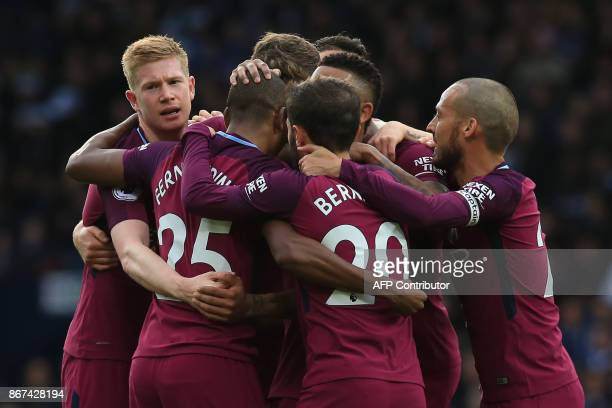 Manchester City's Brazilian midfielder Fernandinho celebrates with teammates scoring the team's second goal during the English Premier League...