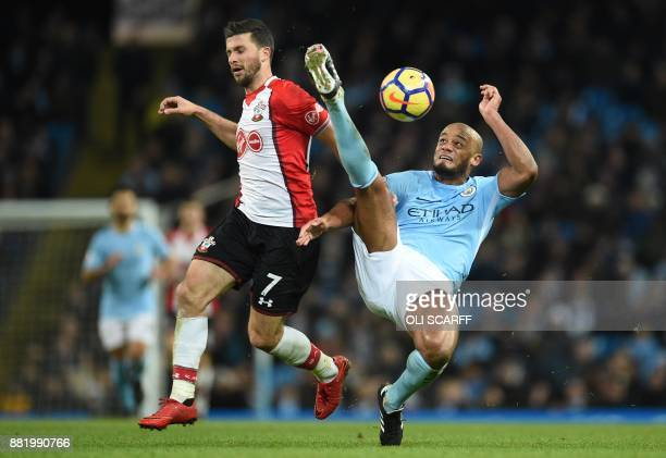 Manchester City's Brazilian midfielder Fernandinho clears the ball from Southampton's Irish striker Shane Long during the English Premier League...