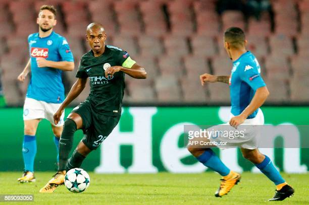 Manchester City's Brazilian midfielder Fernandinho controls the ball in front of Napoli's midfielder from Brazil Allan during the UEFA Champions...