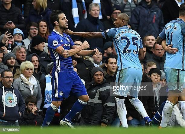 Manchester City's Brazilian midfielder Fernandinho fights with Chelsea's Spanish midfielder Cesc Fabregas following Manchester City's Argentinian...