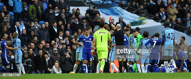 Manchester City's Brazilian midfielder Fernandinho fights with Chelsea's Spanish midfielder Cesc Fabregas as English referee Anthony Taylor shows a...