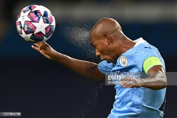 Manchester City's Brazilian midfielder Fernandinho headers the ball during the UEFA Champions League round of 16 second leg football match between...