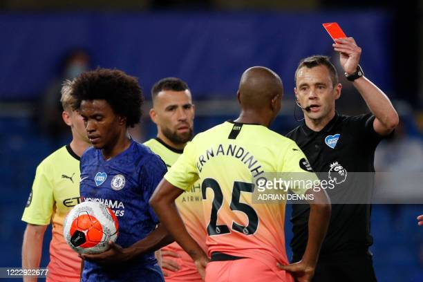 Manchester City's Brazilian midfielder Fernandinho is handed a red card during the English Premier League football match between Chelsea and...