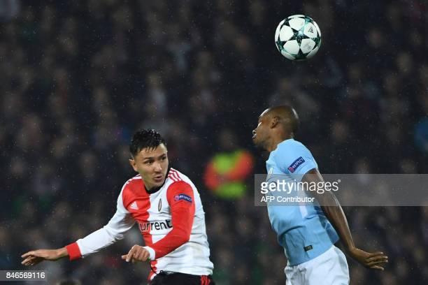 Manchester City's Brazilian midfielder Fernandinho jumps for the ball with Feyenoord's Dutch striker Steven Berghuis during the UEFA Champions League...