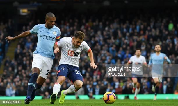 Manchester City's Brazilian midfielder Fernandinho pressures Bournemouth's Scottish midfielder Ryan Fraser during the English Premier League football...
