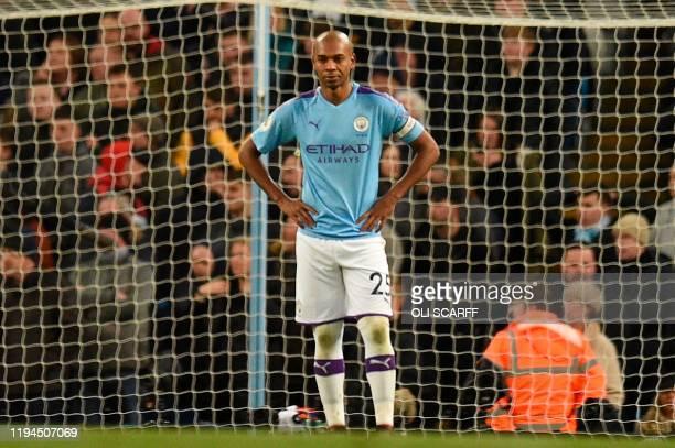 Manchester City's Brazilian midfielder Fernandinho reacts after he scored an own goal during the English Premier League football match between...
