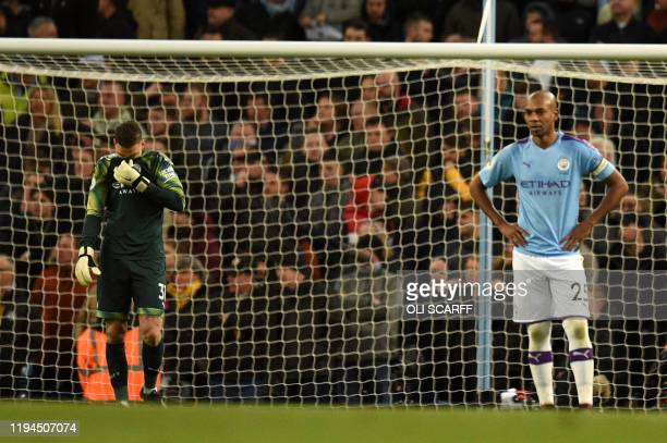 Manchester City's Brazilian midfielder Fernandinho reacts after he scored an own goal as Manchester City's Brazilian goalkeeper Ederson looks on...