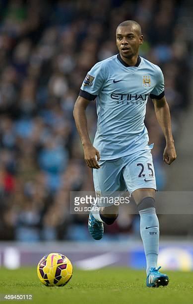 Manchester City's Brazilian midfielder Fernandinho runs with the ball during the English Premier League football match between Manchester City and...