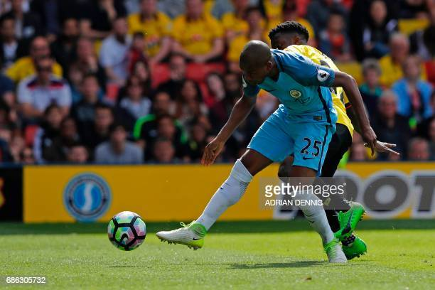 Manchester City's Brazilian midfielder Fernandinho scores his team's fourth goal during the English Premier League football match between Watford and...