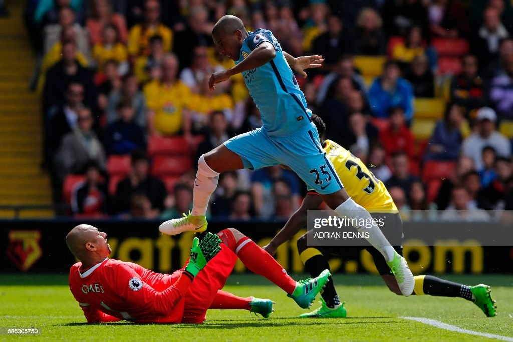 Manchester City's Brazilian midfielder Fernandinho scores his team's fourth goal during the English Premier League football match between Watford and Manchester City at Vicarage Road Stadium in Watford, north of London on May 21, 2017. / AFP PHOTO / Adrian DENNIS / RESTRICTED TO EDITORIAL USE. No use with unauthorized audio, video, data, fixture lists, club/league logos or 'live' services. Online in-match use limited to 75 images, no video emulation. No use in betting, games or single club/league/player publications. /