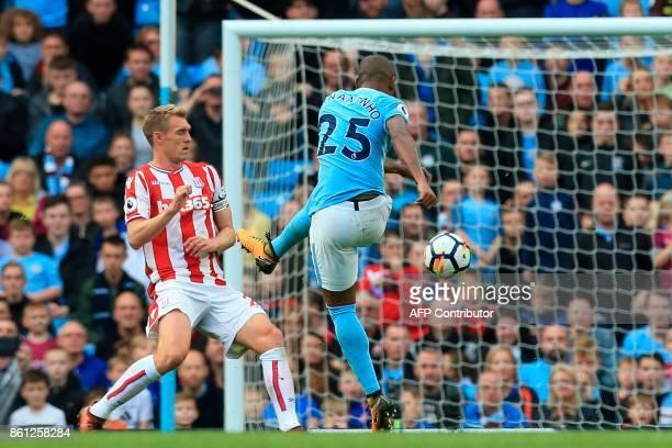 Manchester City's Brazilian midfielder Fernandinho scores their fifth goal during the English Premier League football match between Manchester City...