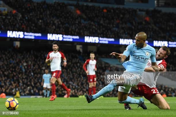 Manchester City's Brazilian midfielder Fernandinho shoots to score the opening goal under pressure from West Bromwich Albion's Northern Irish...