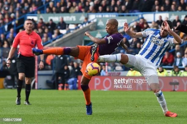 Manchester City's Brazilian midfielder Fernandinho shoots wide past Huddersfield Town's English defender Tommy Smith during the English Premier...