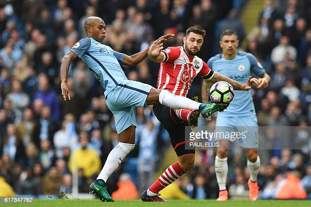 Manchester City's Brazilian midfielder Fernandinho vies with Southampton's English striker Charlie Austin during the English Premier League football...