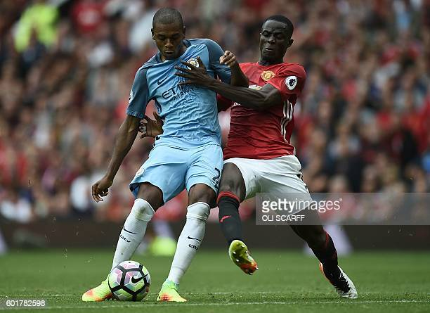 Manchester City's Brazilian midfielder Fernandinho vies with Manchester United's Ivorian defender Eric Bailly during the English Premier League...