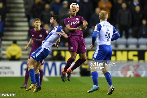 Manchester City's Brazilian midfielder Fernandinho vies with Wigan Athletic's Englishborn Northern Irish striker Will Grigg during the English FA Cup...
