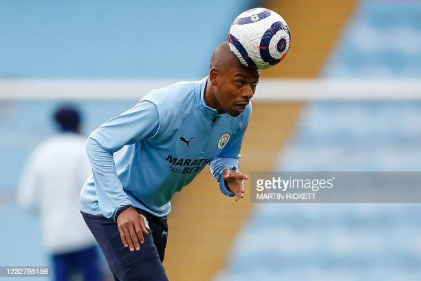 Manchester City's Brazilian midfielder Fernandinho warms up ahead of the English Premier League football match between Manchester City and Chelsea at...