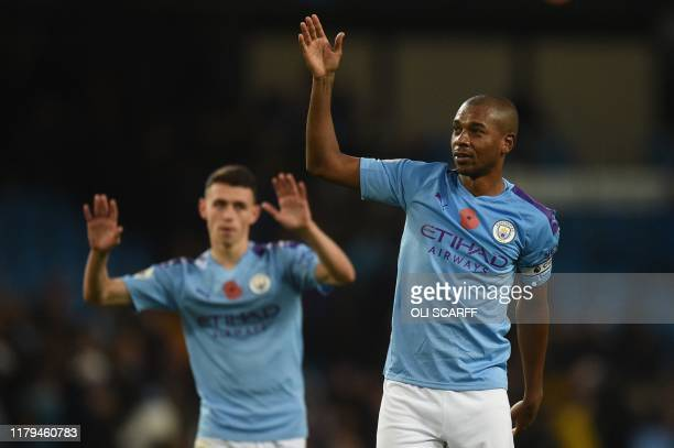 Manchester City's Brazilian midfielder Fernandinho waves to the crowd at the end of the English Premier League football match between Manchester City...