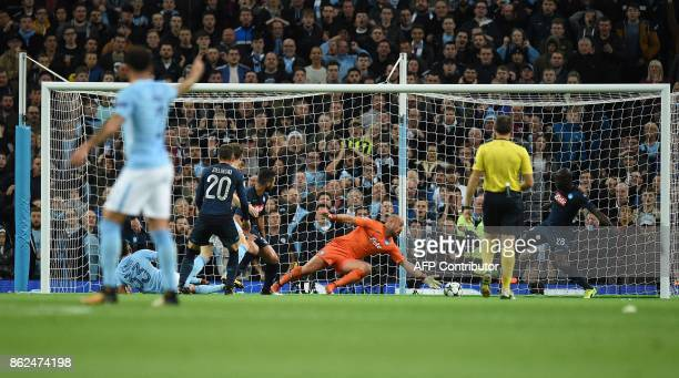 Manchester City's Brazilian striker Gabriel Jesus attempts to shoot past Napoli's Spanish goalkeeper Pepe Reina but fails to score during the UEFA...