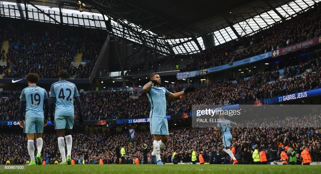 Manchester City's Brazilian striker Gabriel Jesus (C) celebrates after scoring their late winning goal during the English Premier League football match between Manchester City and Swansea City at the Etihad Stadium in Manchester, north west England, on February 5, 2017. Manchester City won the game 2-1. / AFP / PAUL ELLIS / RESTRICTED TO EDITORIAL USE. No use with unauthorized audio, video, data, fixture lists, club/league logos or 'live' services. Online in-match use limited to 75 images, no video emulation. No use in betting, games or single club/league/player publications. /
